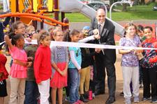 Group of children at a ribbon cutting